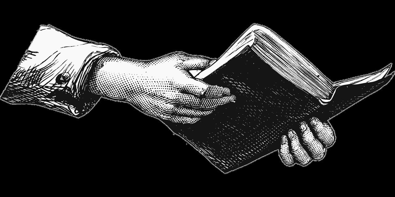 Kniha držena v rukách